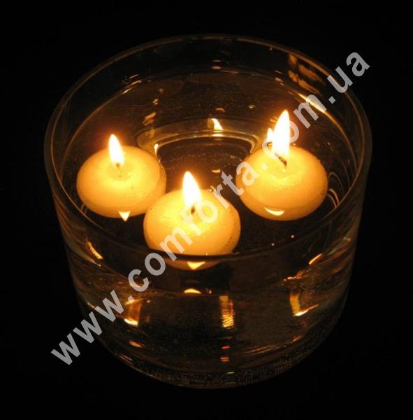 плавающие свечи в количестве 12 шт, размеры 1 свечи, высота - 3 см, диаметр - 4,5 см